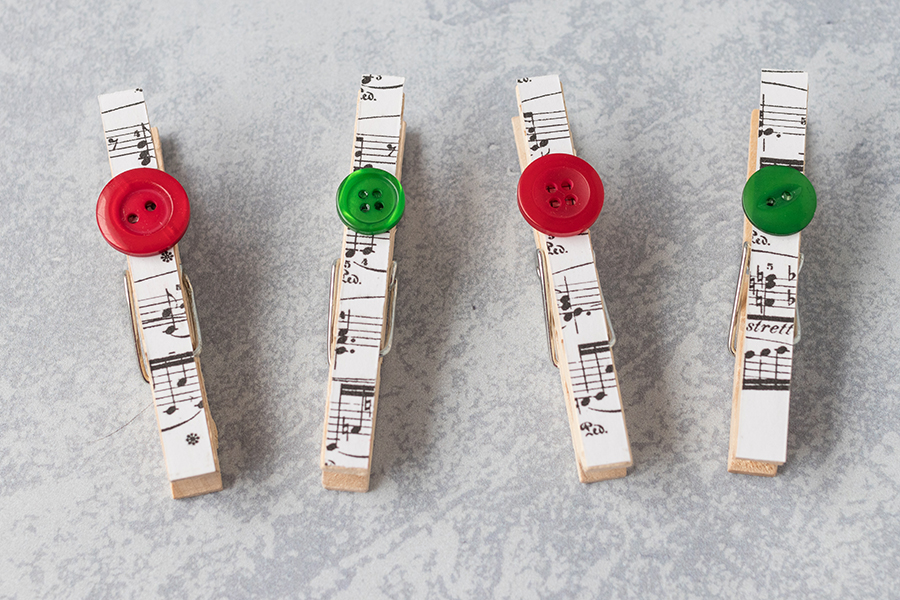 Christmas DIY sheet music clothespin magnets. Simple holiday home decor project! #Christmas #homedecor #clothespins | https://www.roseclearfield.com