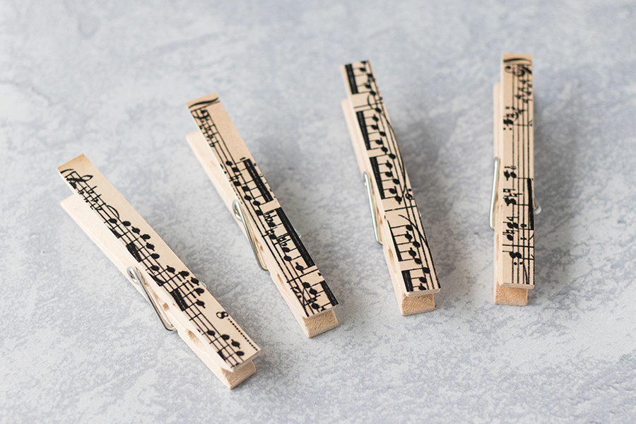 DIY sheet music clothespin magnets are an easy quick home decor project to make for yourself or to give as a gift. #musicteachergift #DIY #homedecor | https://www.roseclearfield.com