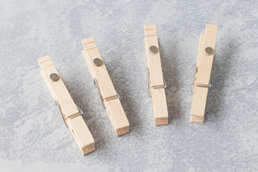 Neodymium magnets adhered to DIY clothespin magnets with E-6000, ready to display on a filing cabinet, magnetic message board, or refrigerator. #DIY #neodymium #magnets   https://www.roseclearfield.com