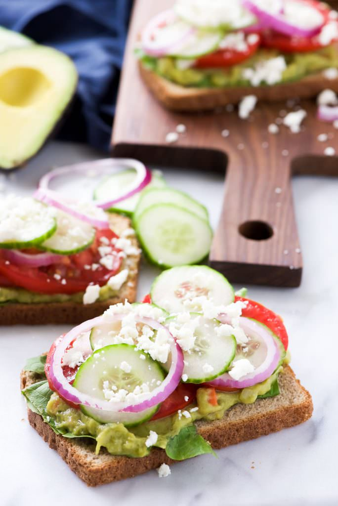 Mediterranean-style avocado toast with cucumber, tomato, red onion, and feta cheese. via With Salt and Wit #Mediterraneancuisine #avocadotoast #healthybreakfast   https://www.roseclearfield.com