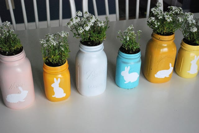 Colorful mason jar planters serve as cheerful Easter decor. #DIYplanters #bunnies #Easter   https://www.roseclearfield.com