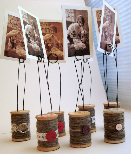 Photo holders made of upcycled wooden spoons, twine, and buttons. So whimsical! via Believe Magic #upcycled #woodenspools #photoholders | https://www.roseclearfield.com