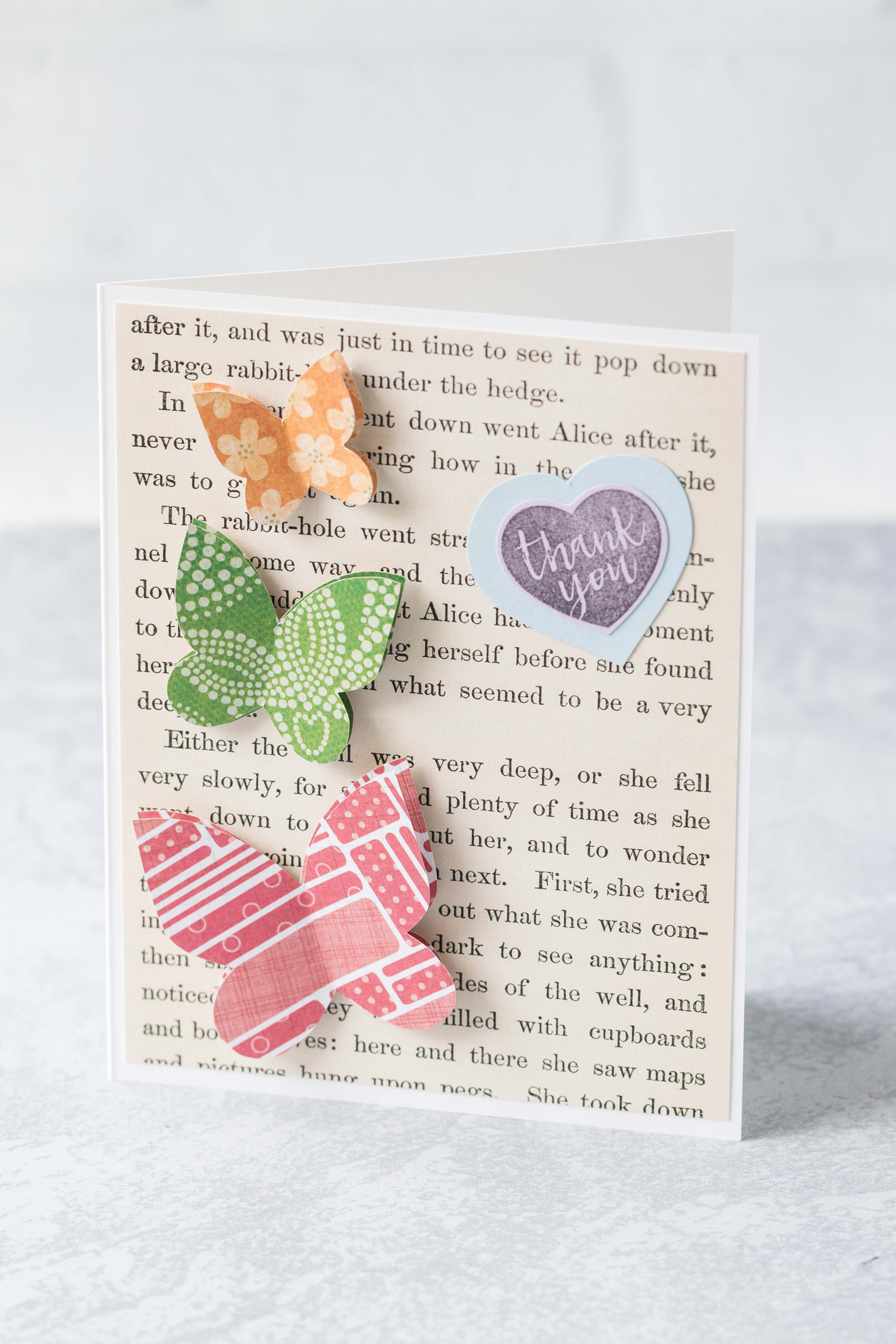 Thank you card with Alice in Wonderland book page background and scrapbook paper butterflies. #thankyoucard #greetingcard #AliceinWonderland #butterflies | https://www.roseclearfield.com