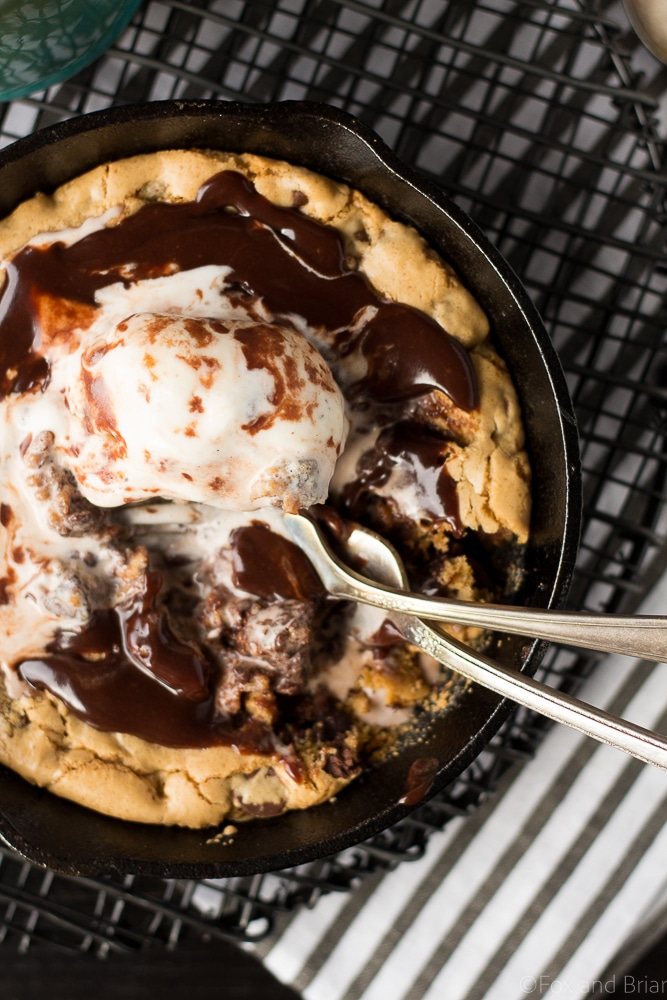 Chocolate chip cookie blondie skillet sundae for two. A rich treat perfect for date night or a special occasion! #skilletdessert #chocolatechipcookie #dessertfortwo | https://www.roseclearfield.com