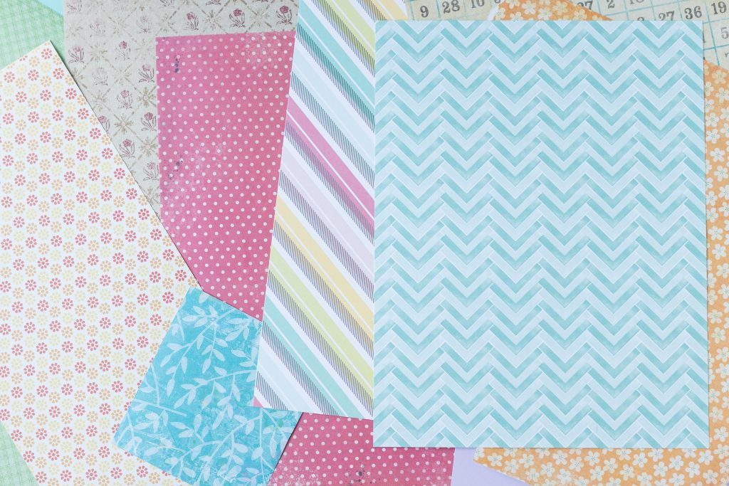 Card stock and scrapbook paper to make DIY scrapbook embellishments. #cardstock #scrapbookpaper #DIYscrapbookembellishments | https://www.roseclearfield.com