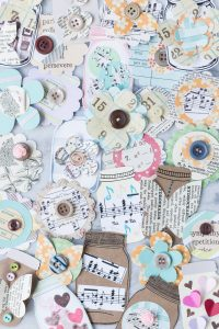 Learn how to make your own scrapbook embellishments! DIY embellishments add a personal touch to scrapbook layouts as well as cards, gift tags, wrapping paper, junk journals, and much more! #DIY #scrapbooking #scrapbookembellishments
