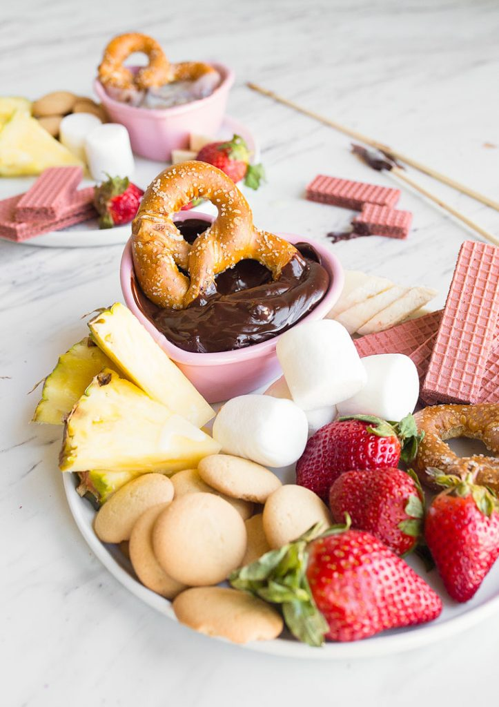 Easy chocolate fondue for two via Dessert for Two. A fun, simple date night dessert! #chocolatefondue #dessertrecipe #datenight | https://www.roseclearfield.com