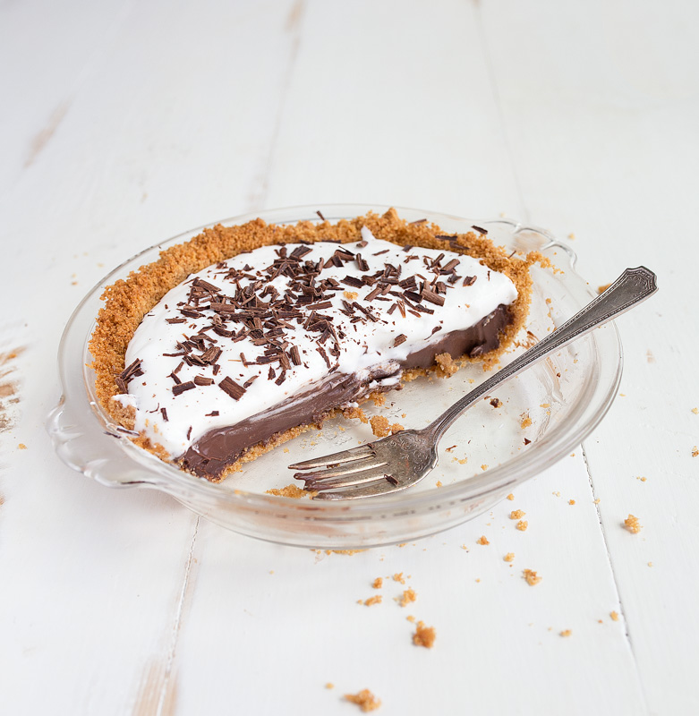 Mini chocolate cream pie for two via Dessert for Two. The perfect serving of rich chocolate cream pie! #chocolatecreampie #minipie #dessertfortwo | https://www.roseclearfield.com