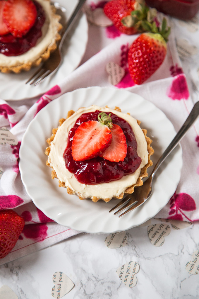 No-bake strawberry cheesecakes for two. Simple, delicious date night recipe! via Annie's Noms #nobake #strawberrycheesecake #dessertfortwo | https://www.roseclearfield.com
