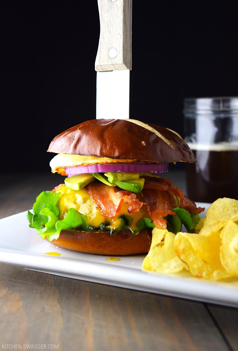 Bacon, egg, and avocado cheeseburger. Fabulous topping combination! via Kitchen Swagger #baconburger #putaneggonit #cheeseburger   https://www.roseclearfield.com