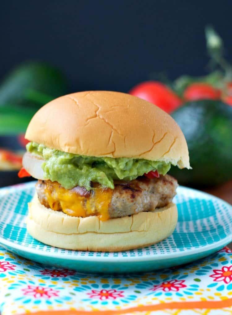 Chicken fajita burgers via The Seasoned Mom. All of the flavors of fajitas in a chicken burger! #chickenburger #fajitaburger #grillingrecipe | https://www.roseclearfield.com