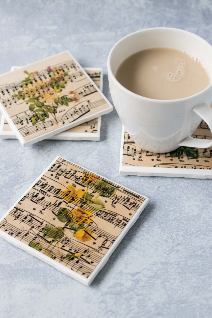 DIY vintage sheet music botanical tile coasters. Beautiful drink coasters or home decor! #DIY #vintagesheetmusic #botanicalcoasters | https://www.roseclearfield.com