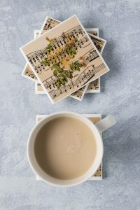 DIY vintage sheet music floral tile coasters. Perfect home decor project for anyone who loves sheet music crafts! #sheetmusic #tilecoasters #DIYhomedecor | https://www.roseclearfield.com