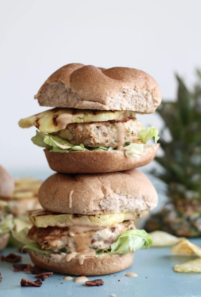 Grilled pineapple bacon chicken burgers, topped with barbecue mayo. A delicious summer dinner! via Spices in My DNA #grilling #chickenburgers #baconburgers | https://www.roseclearfield.com