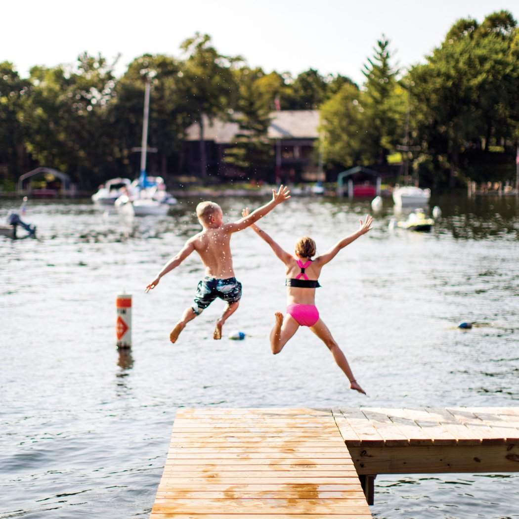 Lake Minnetonka by Ryan Donnell via Mpls St. Paul Mag #dockjump #summerfun | https://www.roseclearfield.com
