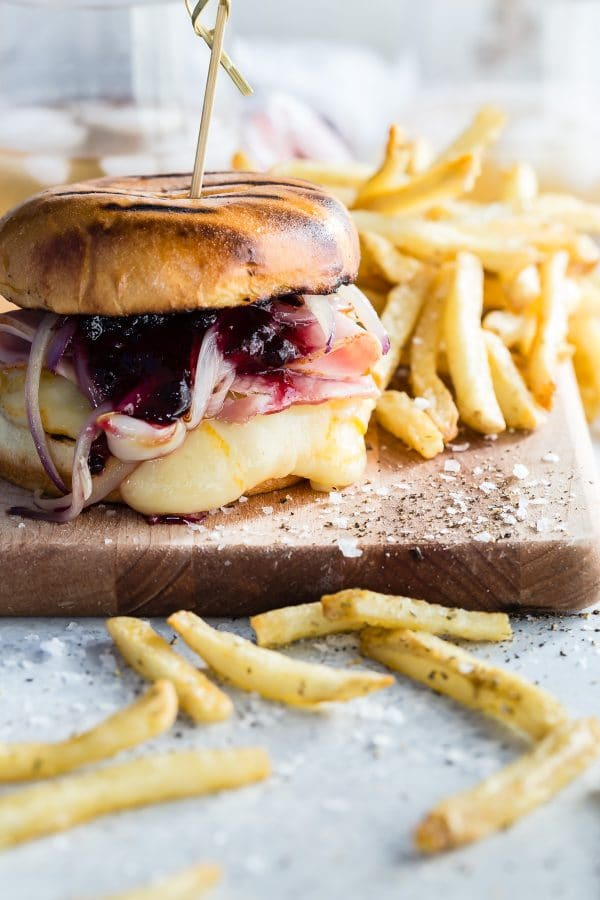 Monte Criso burger topped with smoked ham, blueberry jam, and muenster cheese. Amazing flavor combination! via Foodness Gracious #MonteCristo #burger #grilling   https://www.roseclearfield.com