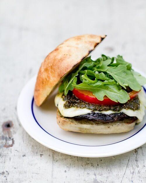 Pesto portobello mushroom burger via A Couple Cooks. Delicious vegetarian burger with so much flavor! #portobelloburger #portobellomushroom #pesto | https://www.roseclearfield.com