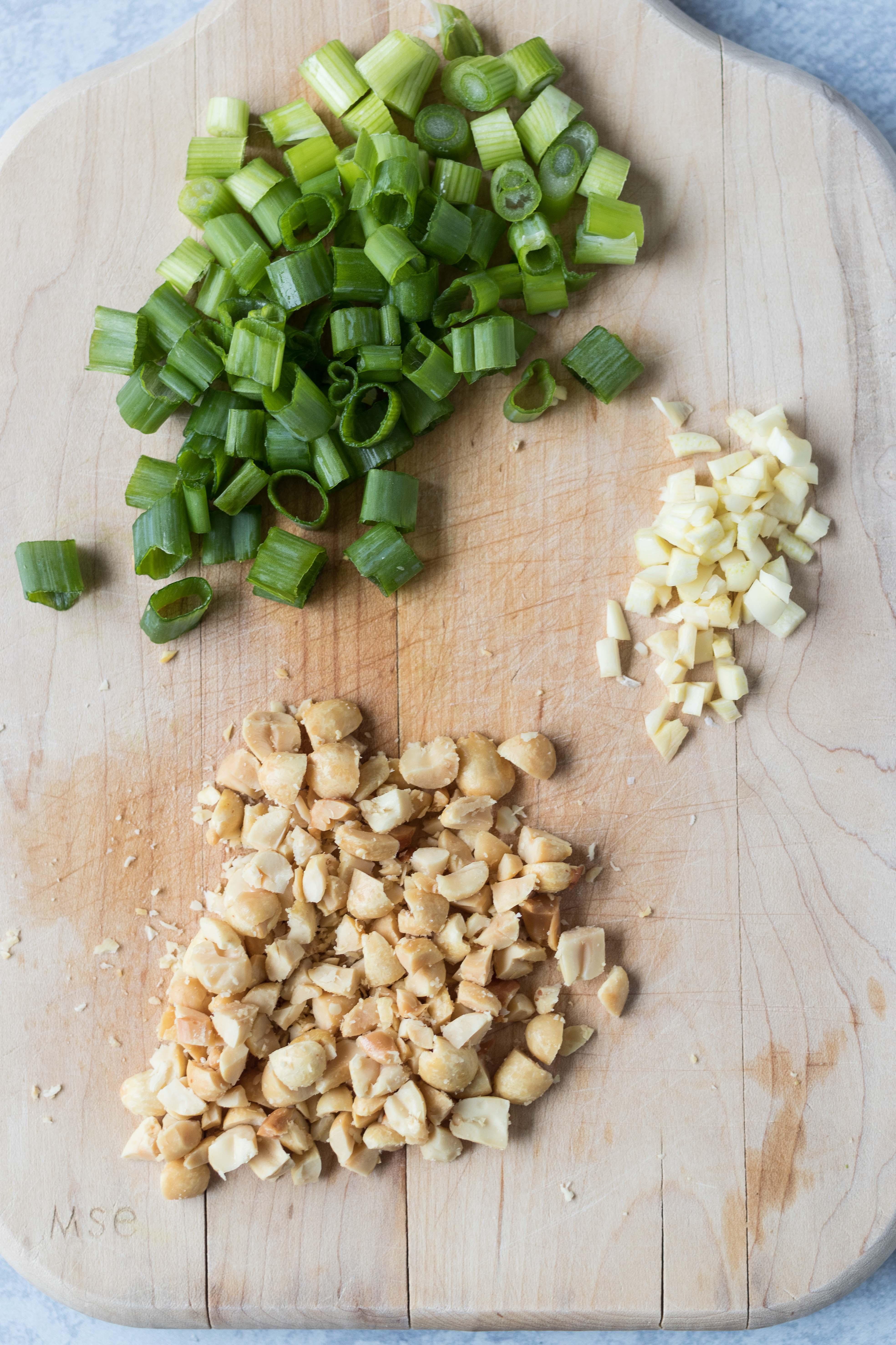 Chopped green onion, peanuts, and garlic for peanut sesame Ramen. Quick, healthy lunch dish! #healthylunchidea #sesameRamen #peanutnoodles | https://www.roseclearfield.com