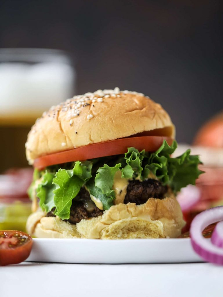 Smoked gouda smash burgers with house sauce from How Sweet Eats. Perfect for summer grilling! #smashburgers #goudaburgers #grilling   https://www.roseclearfield.com