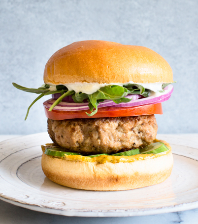 Mediterranean turkey burger with cucumber, tomato, red onion, arugula, and whipped feta. Packed with flavor! via Kitchen Konfidence   https://www.roseclearfield.com