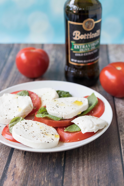 Caprese salad. Simple, nutritious summer recipe, perfect for seasonal tomatoes and basil. #caprese #capresesalad #capreserecipes | https://www.roseclearfield.com