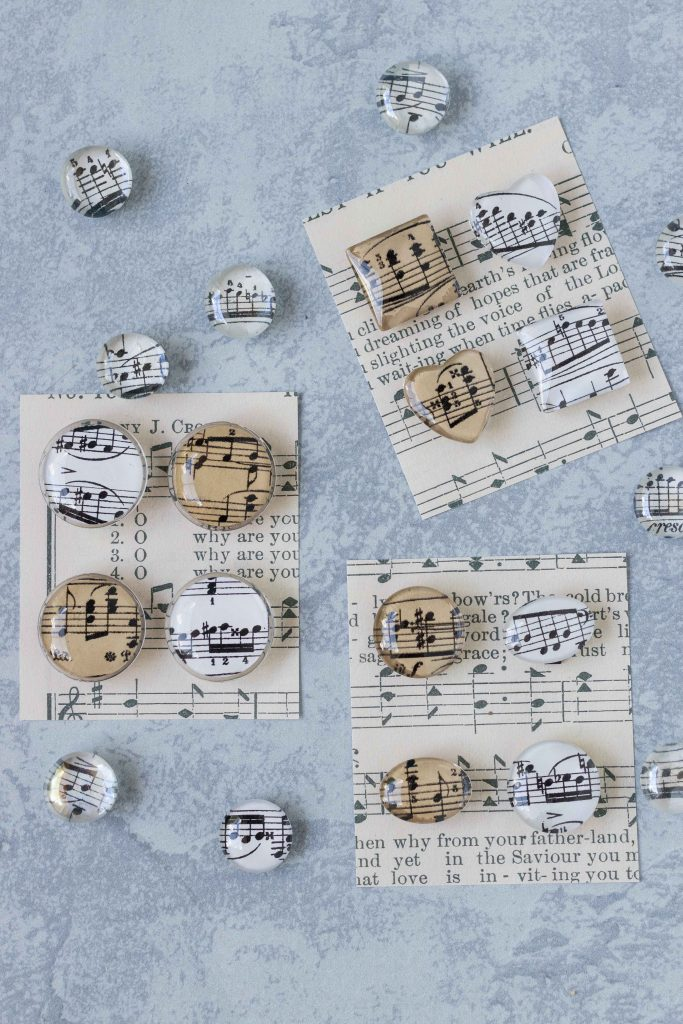 DIY sheet music glass magnets. Easy home decor to make with kids! #DIY #sheetmusic #glassmagnets