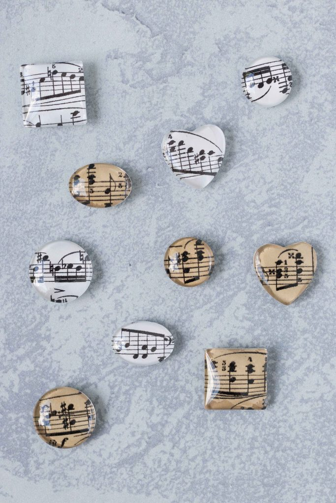 DIY sheet music glass magnets in assorted shapes. Easy home decor craft project! #DIY #homedecor #sheetmusic #glassmagnets