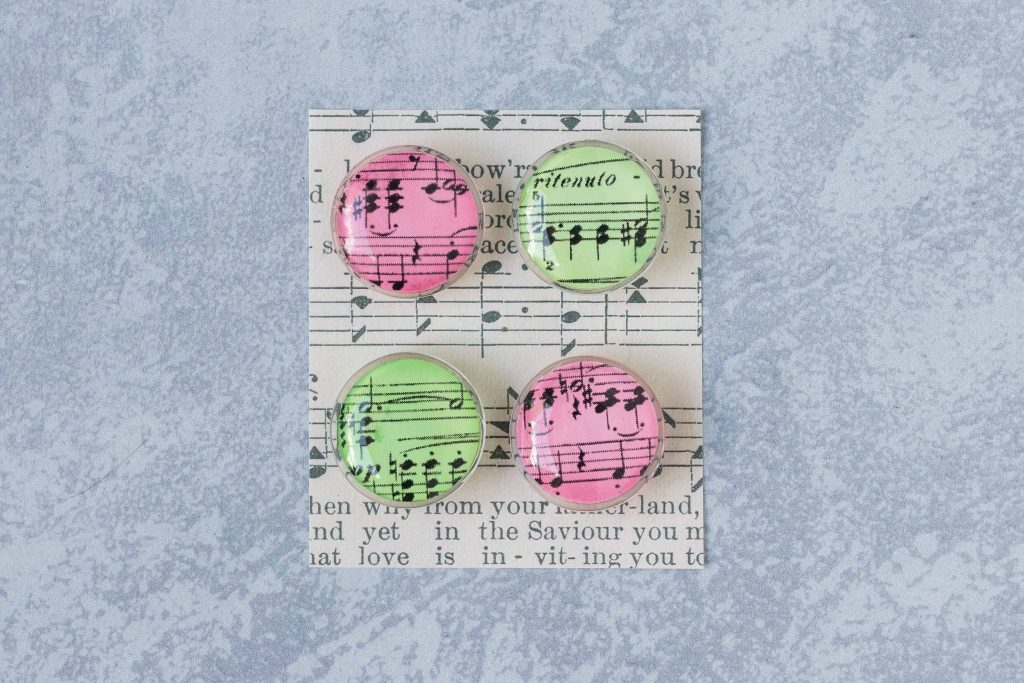 DIY Christmas sheet music glass magnets. An easy, festive craft project to give as gifts or sell on Etsy or at craft fairs. #DIY #sheetmusic #Christmascraft