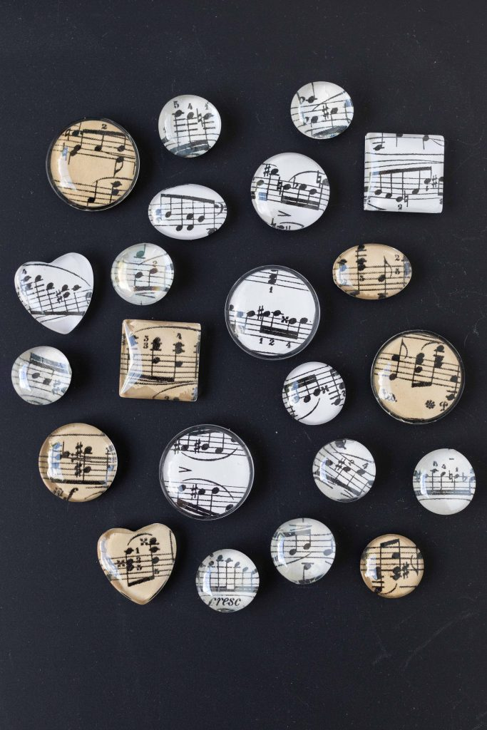 DIY sheet music glass magnets. Easy home decor project to sell or give as gifts or party favors! #sheetmusic #glassmagnets #DIY | https://www.roseclearfield.com