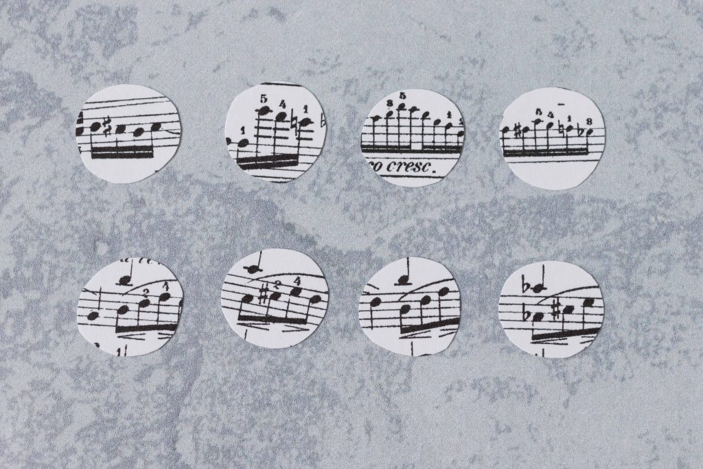 Sheet music circles, ready to be made into glass magnets. #DIY #glassmagnets #sheetmusiccraft