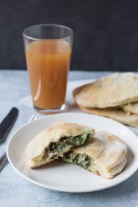 Cheesy Spinach Sausage Calzones