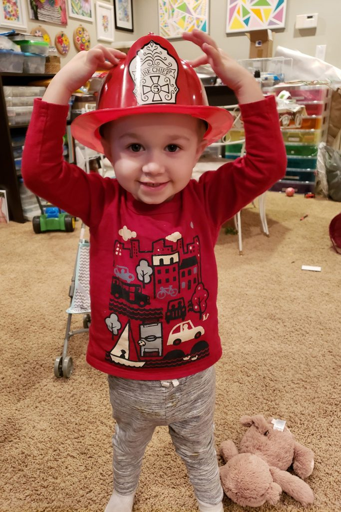 Toddler with Fireman Hat