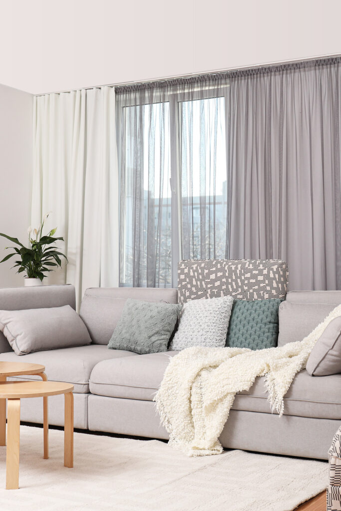 Living Room With Throw Blanket and Pillows
